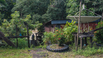 A man walks up toward his home from the river bank in the Long Liam village along the Baram River in Borneo, Malaysia