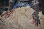 An elderly woman weaves a traditional hat in the Long Naah'a village along the Baram River in Borneo, Malaysia